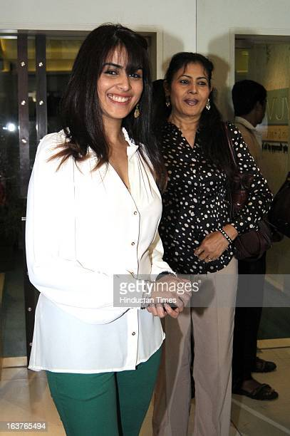 Bollywood actor Genelia D'Souza poses during the celebration of Dr Rekha Sheth's Maria Duran Lectureship award at Juhu on March 13 2013 in Mumbai...