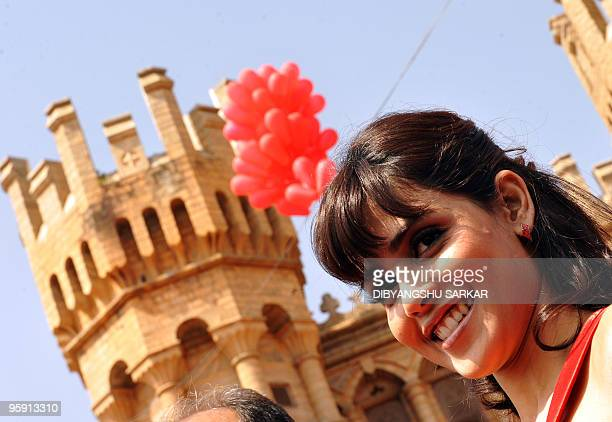 Bollywood actor Genelia D'Souza poses in front of the Bangalore Palace at Virgin Mobiles GSM service launche in Bangalore on January 21 2010 Virgin...