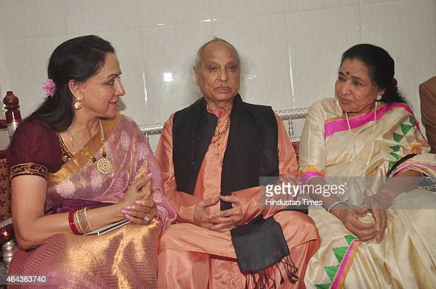 Bollywood actor Hema Malini playback singer Asha Bhosle and classical singer Pandit Jasraj during the launch of Shri Hari Vani Gita album by Veena...