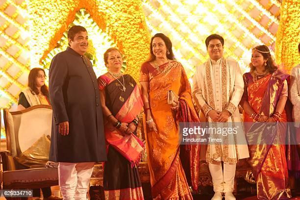 Bollywood actor Hema Malini poses with Union Minister Nitin Gadkari his wife Kanchan Gadkari and their newlywed daughter Ketki and soninlaw Aditya...