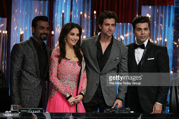 Bollywood actor Hrithik Roshan with Remo D'souza Madhuri Dixit and Karan Johar at Jhalak Dikhla Ja set for the promotion of his upcoming movie...