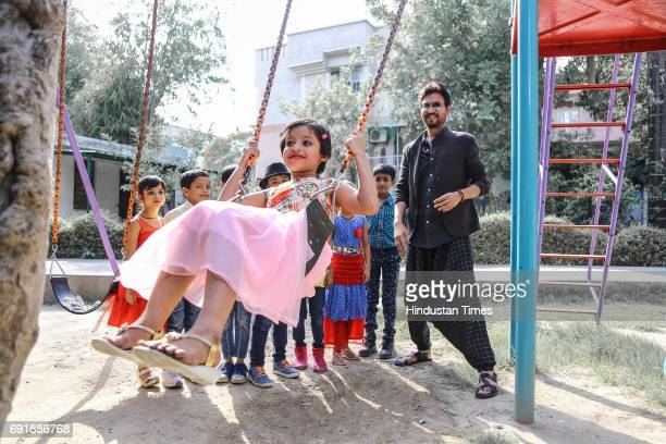 """Bollywood actor Irrfan Khan posing with kids during an exclusive shoot for Hindustan Times' """"Paathshala"""", an initiative that supports and funds the..."""