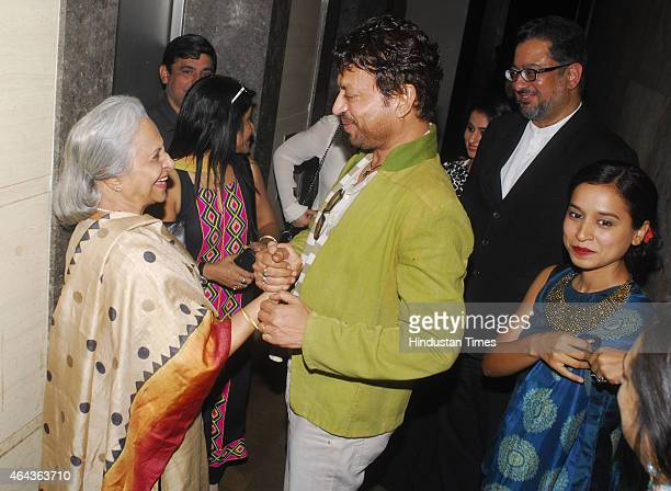 Bollywood actor Irrfan Khan talks with veteran actress Waheeda Rehman as Bollywood filmmaker Anup Singh and actor Tillotama Shome look during the...
