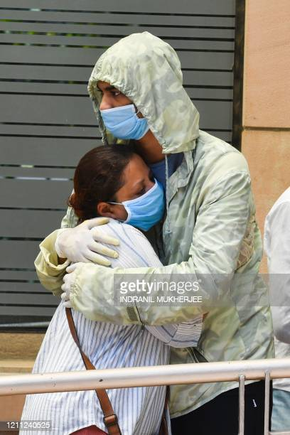 TOPSHOT Bollywood actor Irrfan Khan's elder son Babil Khan is comforted by a woman at the Kokilaben Ambani hospital in Mumbai on April 29 2020...