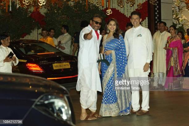 Bollywood actor Jackie Shroff and actor Madhuri Dixit with her husband Sriram Nene attend the Ganesh Chaturthi festival celebrations at Antilia...