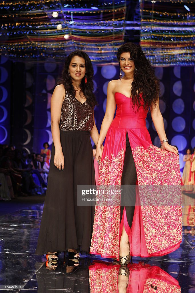 Bollywood actor Jacqueline Fernandez on the ramp with fashion designer Jyotsna Tiwari during the Indian Bridal Fashion Week held at The Grand on July.