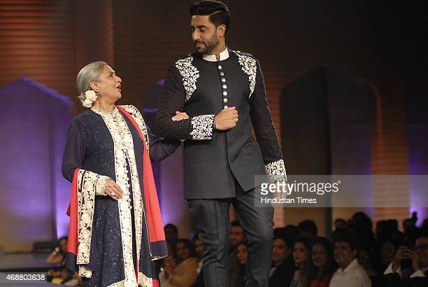 Bollywood actor Jaya Bachchan with her son and actor Abhishek Bachchan walk on the ramp during fund raising fashion show oraganized by NGO Mijwan at...