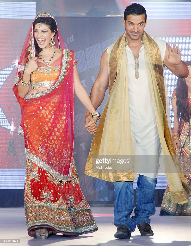 Bollywood actor John Abraham and Jacqueline Fernandez walk the ramp wearing creations by designer Aki Narula during the promotion of their upcoming...