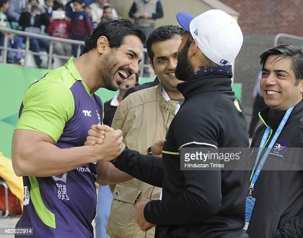 Bollywood actor John Abraham meets with Delhi Waveriders Captain Sardar Singh during a match between Delhi Waveriders and Dabang Mumbai during the...