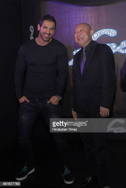 Bollywood actor John Abraham with Masaki Asano MD Yamaha Motors India during the launch of Yamaha Fascino 2015 calendar on January 13 2015 in Mumbai...