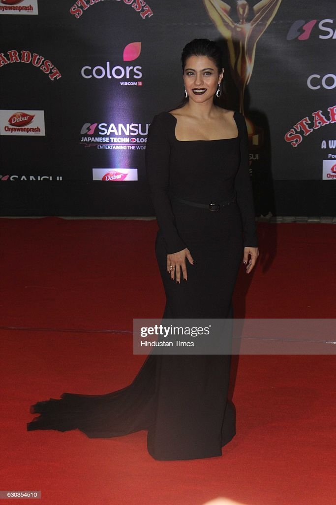 Bollywood actor Kajol Devgan poses on red carpet for shutterbugs during the Sansui Colors Stardust Awards 2016 on December 19 2016 in Mumbai India