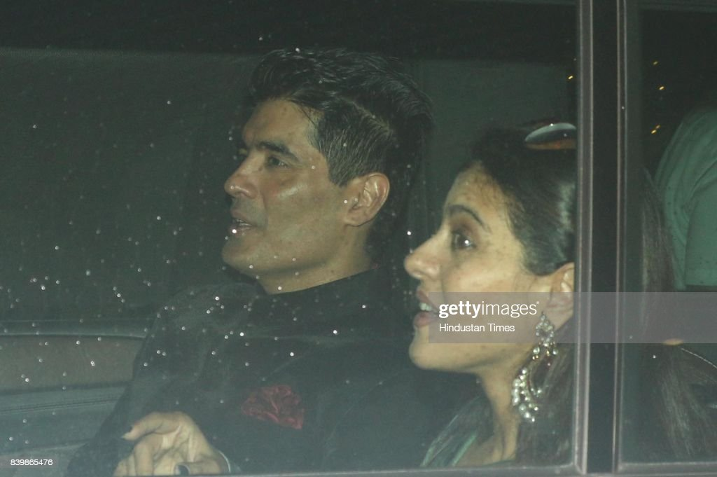 Bollywood actor Kajol with designer Manish Malhotra during the Ganesh Puja hosted by Mukesh Ambani Chairman of Reliance Industries Ltd at his...