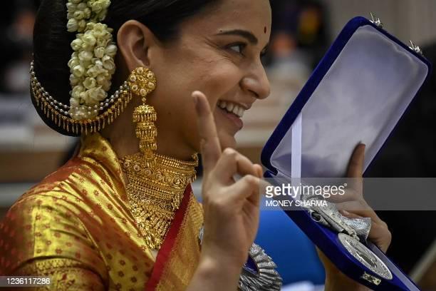 Bollywood actor Kangana Ranaut gestures during the 67th National film awards and Dadasaheb Phalke Awards 2019 held in New Delhi on October 25, 2021.