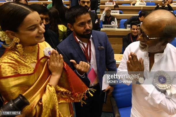Bollywood actor Kangana Ranaut greets actor Rajinikanth as they attend the 67th National film awards and Dadasaheb Phalke Awards 2019 held in New...