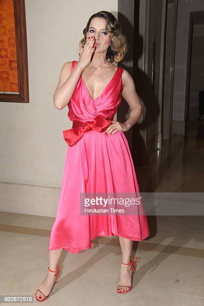 Bollywood actor Kangana Ranaut poses for shutterbugs during the party by Hollywood actor Jackie Chan at JW Marriot on January 23 2017 in Mumbai India...