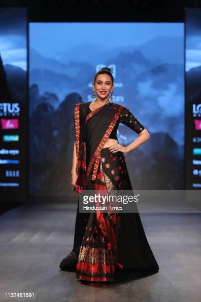 Bollywood actor Karisma Kapoor walks the ramp for Morom by Designer Sanjukta Dutta at Lotus Make-Up India Fashion Week Autumn Winter' 2019, at...