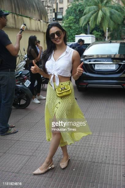 Bollywood actor Kiara Advani strikes a pose for the camera as she celebrates the success of her film Kabir Singh in Andheri on June 24 2019 in Mumbai...