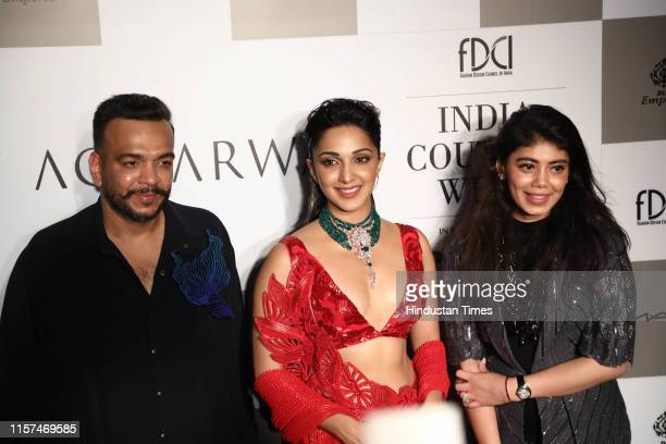 Bollywood actor Kiara Advani with designers Amit Aggarwal and Tanira Sethi at the first day of the 12th edition of the FDCI India Couture Week on...