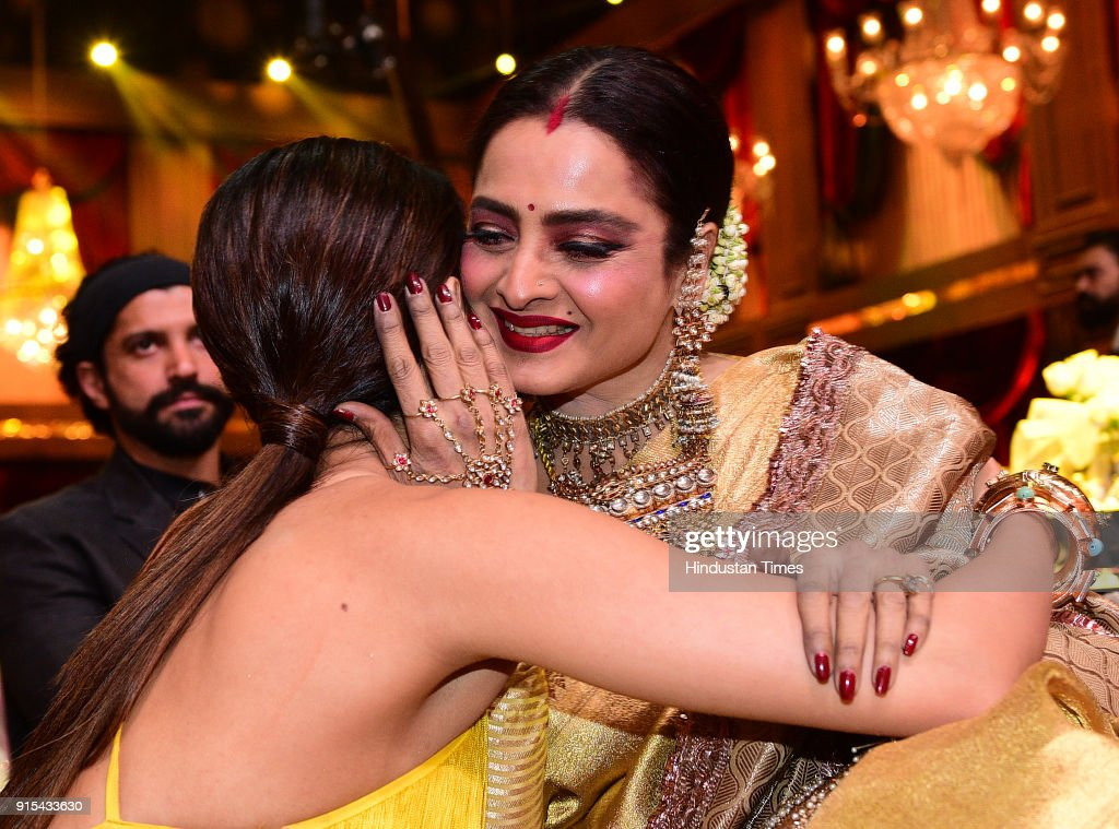 Bollywood actor Kriti Sanon hugs veteran actor Rekha during Hindustan Times India's Most Stylish Awards at Yash Raj Films Private Limited on Janua