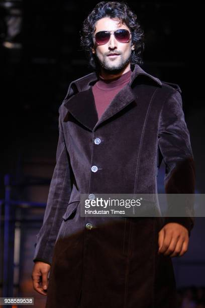 Bollywood actor Kunal Kapoor walks the ramp for designers Rohit Gandhi and Rahul Khanna's show at Wills Lifestyle India Fashion Week 2008 in New Delhi