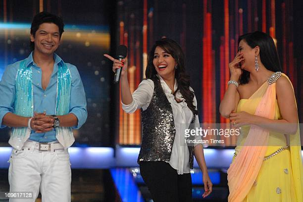 Bollywood actor Madhuri Dikshit with television actor Shweta Tiwari and singer Shaan during the first look of the dance reality show Jhalak Dikhla...