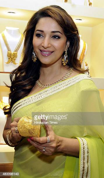 Bollywood actor Madhuri Dixit during an inauguration of a new jewellery showroom PN Gadgil Jewellers on August 7 2015 in Indore India Dixit said 'It...