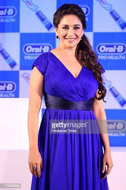 Bollywood actor Madhuri Dixit during the launch of OralB Pro Health toothpaste at Shangrila Hotel Lower Parel on July 2 2013 in Mumbai India