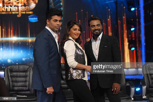 Bollywood actor Madhuri Dixit filmmaker Karan Johar and choreographer Remo D'Souza during the first look of the dance reality show Jhalak Dikhla Jaa...
