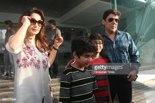 Bollywood actor Madhuri Dixit Nene along with her husband Sriram Nene and children Raayan Nene and Arin Nene during the Disney India's Beauty and the...