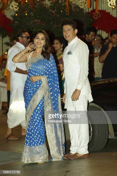 Bollywood actor Madhuri Dixit with her husband Sriram Nene attends the Ganesh Chaturthi festival celebrations at Antilia Mukesh Ambani's residence...
