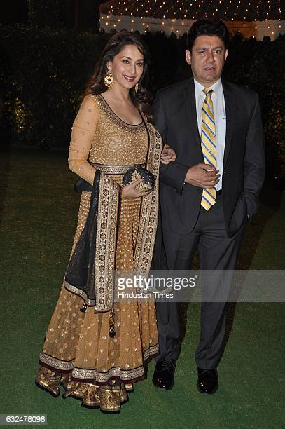 Bollywood actor Madhuri Dixit with husband Ram Nene during wedding reception of Trishya Screwvala daughter of media tycoon and philanthropist Ronnie...