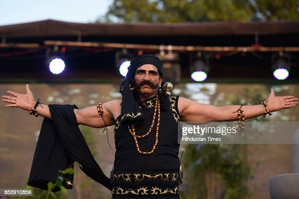 Bollywood actor Mukesh Rishi plays the role of Ravana during the Dussehra festival celebration at Lal Quila Grounds on September 30 2017 in New Delhi...