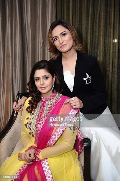 Bollywood actor Nagma with makeup expert Aashmeen Munjaal during unveiling of Regal Couture Collection and MakeUp Trends 2013 by Designer Preeti Ghai...