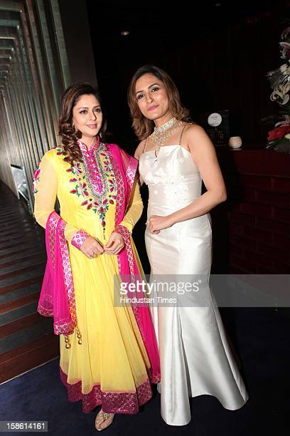Bollywood actor Nagma with makeup expert Aashmeen Munjal during unveiling of Regal Couture Collection and MakeUp Trends 2013 by Designer Preeti Ghai...