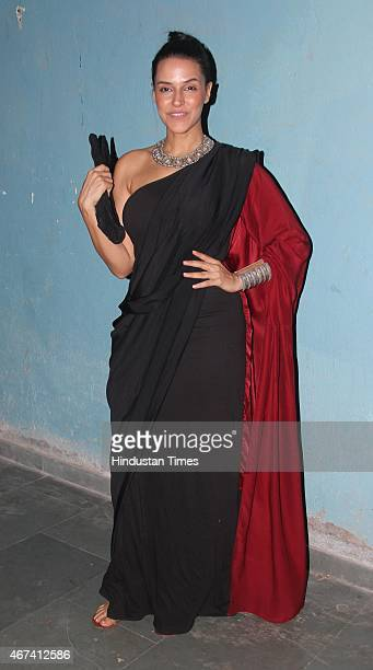 Bollywood actor Neha Dhupia during the Manish Malhotras show at Lakme Fashion Week Summer/Resort 2015 on March 18 2015 in Mumbai India