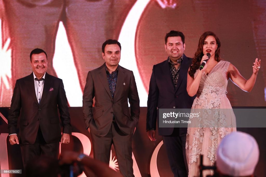 Bollywood actor Neha Dhupia Rakesh Kapoor Elan Group Chairman with Directors Akash Kapoor and Ravish Kapoor during the launch of prestigious project..