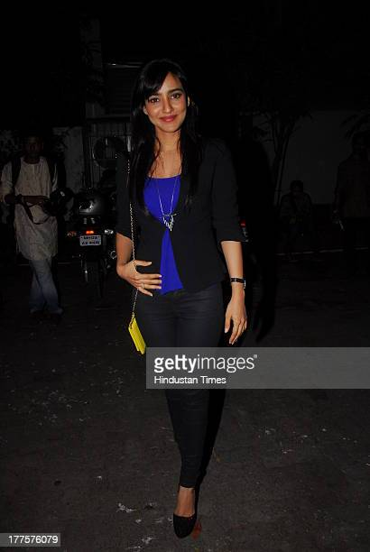 Bollywood actor Neha Sharma during the special screening of film Madras Cafe at Sunny Super Sound Studio Juhu on August 21 2013 in Mumbai India...