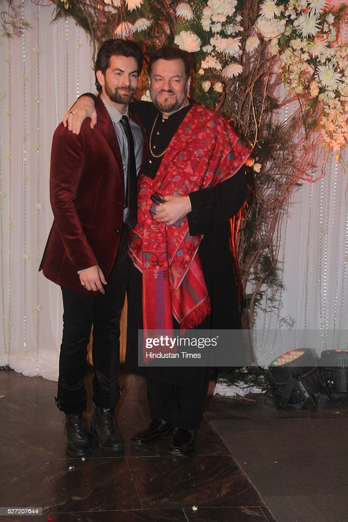 Bollywood actor Neil Nitin Mukesh with his father Nitin Mukesh at wedding reception of couple Bipasha Basu and Karan Singh on April 30 2016 in Mumbai.