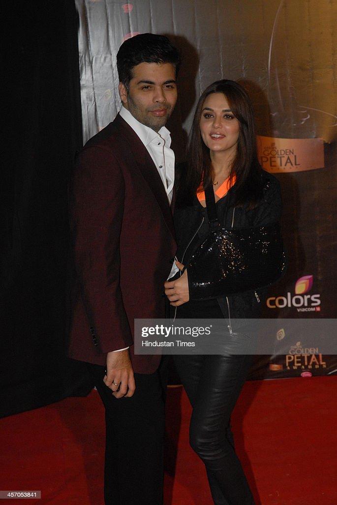 Bollywood actor Preity Zinta and Karan Johar during the Colors TV 3rd Golden Petal Awards on December 14 2013 in Mumbai India