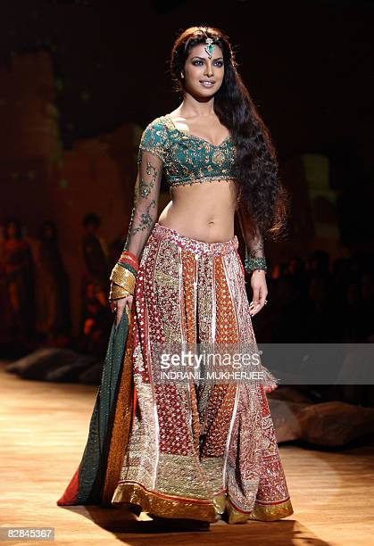 Bollywood actor Priyanka Chopra displays a creation by Indian designer Ritu Kumar on the inaugural day of the �HDIL India Couture Week� in Mumbai on...