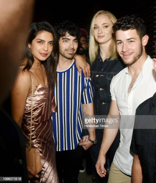 Bollywood actor Priyanka Chopra with her fiancee Nick Jonas his brother Joe Jonas and his fiancee Sophie Turner posed for photographs outside a...