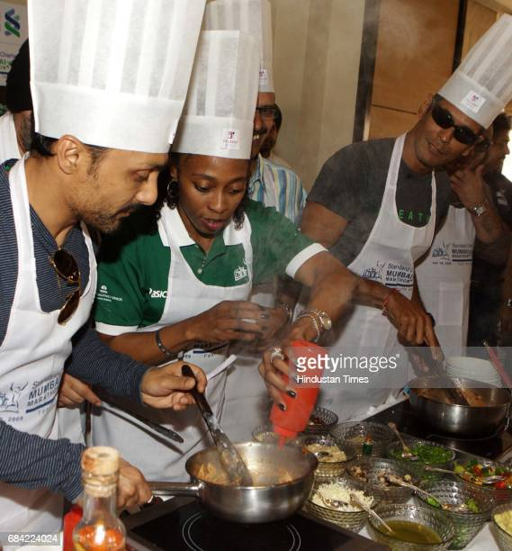 Bollywood actor Rahul Bose Former US Olympian and Mumbai Marathon brand ambassador Gail Devers and Milind Soman try their hands at cooking on the eve...