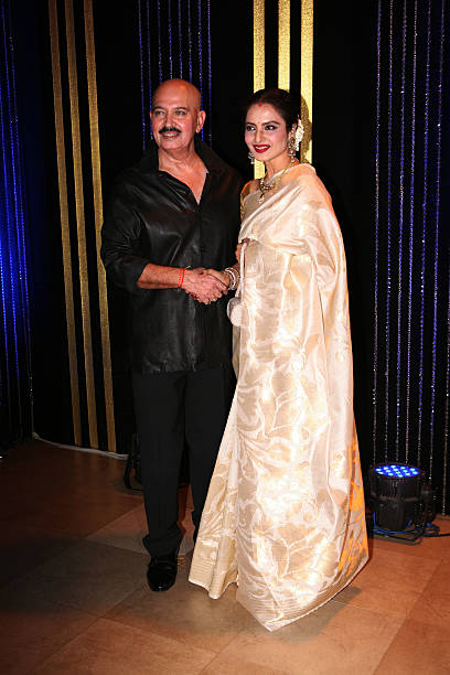Bollywood actor Rakesh Roshan with actress Rekha at his 64th birthday celebrations at Blue Sea Worli Seaface on September 6 2013 in Mumbai