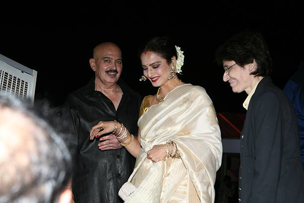 Bollywood actor Rakesh Roshan with Rekha at his 64th birthday celebrations at Blue Sea Worli Seaface on September 6 2013 in Mumbai