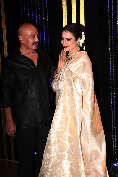 Bollywood actor Rakesh Roshan with Rekha during his 64th birthday celebrations at Blue Sea Worli Seaface on September 6 2013 in Mumbai