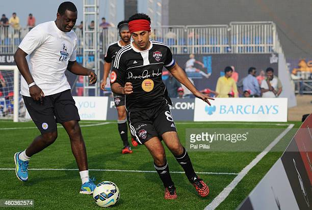 Bollywood actor Ranbir Kapoor tackles Emile Heskey Leicester city Legend in action during an exhibition match played between BPL legends and All star...