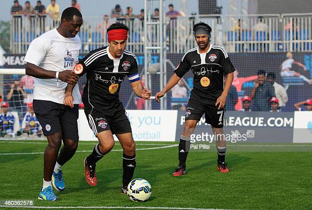 Bollywood actor Ranbir Kapoor tackles Emile Heskey Leicester city legend during an exhibition match played between BPL legends and All star FC from...