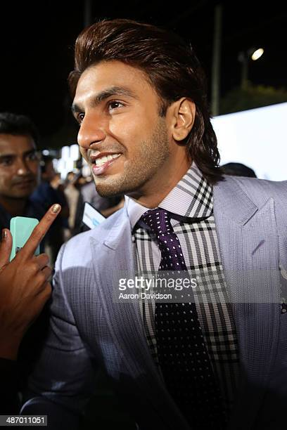Bollywood actor Ranveer Singh is interviewed on the green carpet before the IIFA Awards at Raymond James Stadium on April 26 2014 in Tampa Florida