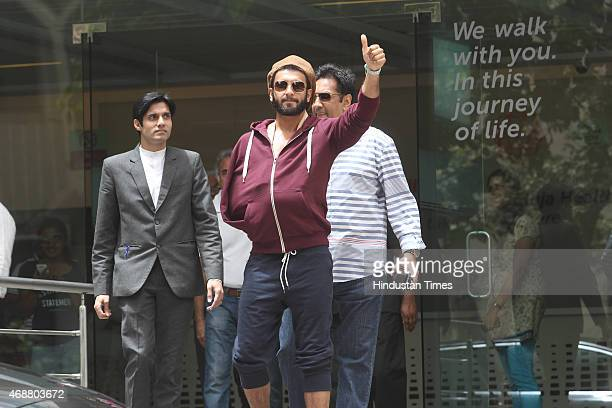 Bollywood actor Ranveer Singh poses for the media after being discharged from hospital at Khar on April 5 2015 in Mumbai India Ranveer Singh...