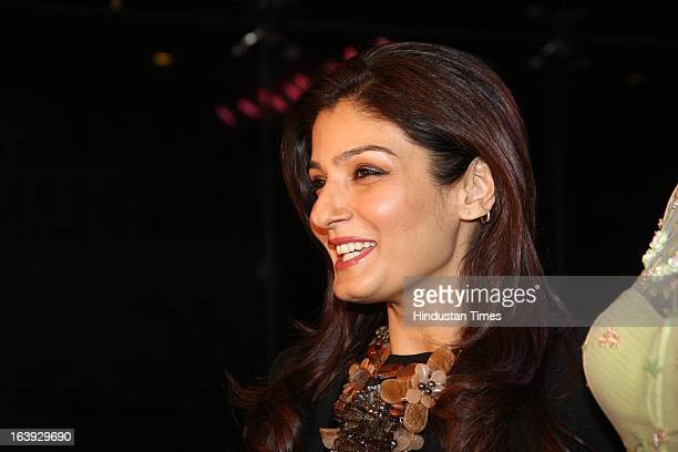 Bollywood actor Raveena Tandon poses during the launch of Lakme Fashion week collection of fashion designer Sonakshi Raaj on March 15 2013 in Mumbai...